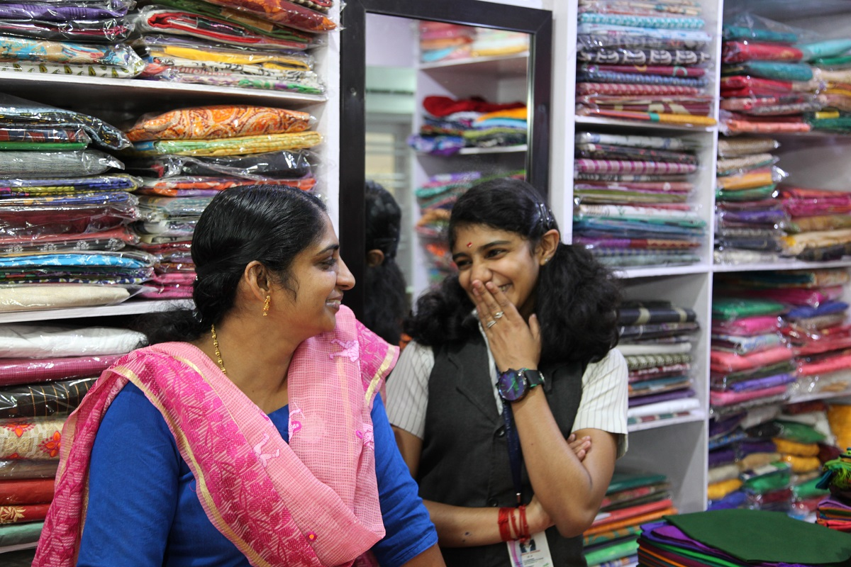 Sajitha (left) and her daughter, Swati (right), at the shop. ©2018 World Vision, Namitha Lizbeth.