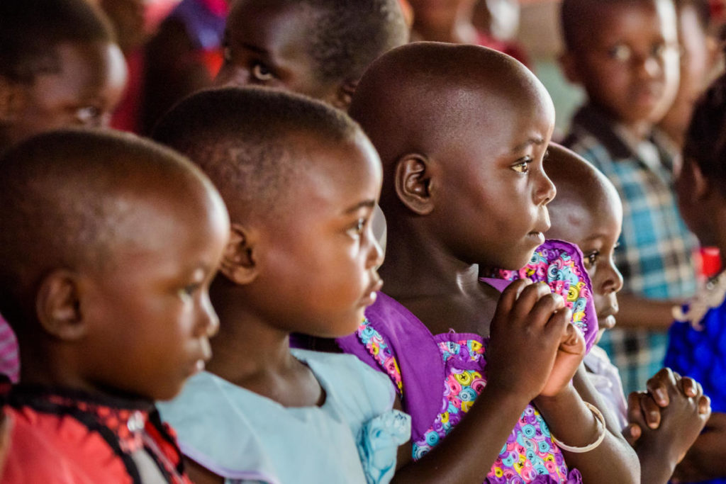 A children's choir in Uganda that includes many of Josephine's grandchildren. Josephine says frequent malaria is a challenge – they sleep under nets, but it's hard to stay covered. She cares for her grandchildren because three of her daughters died of HIV/AIDS.