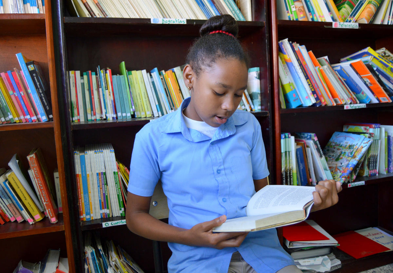 Selina participates in a reading program sponsored by World Vision in the Dominican Republic.