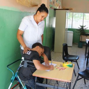 Yadiel works on reading with World Vision program in the Dominican Republic.