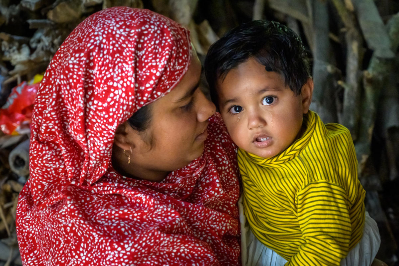 Fatema with her 19 month-old daughter, Habiba, who, even though sheis in tears, has excellent health because of nutrition tips Fatema learned from Nobo Jatra training, through World Vision in Bangladesh.