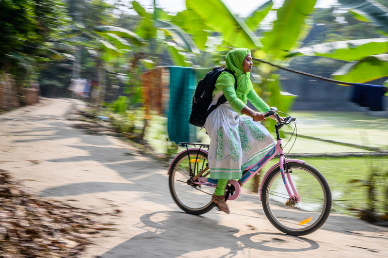 Nobo Jatra's nutrition facilitator, Rumana, rides her pink bicycle from house to house, educating pregnant mothers on how to care for themselves and their babies.