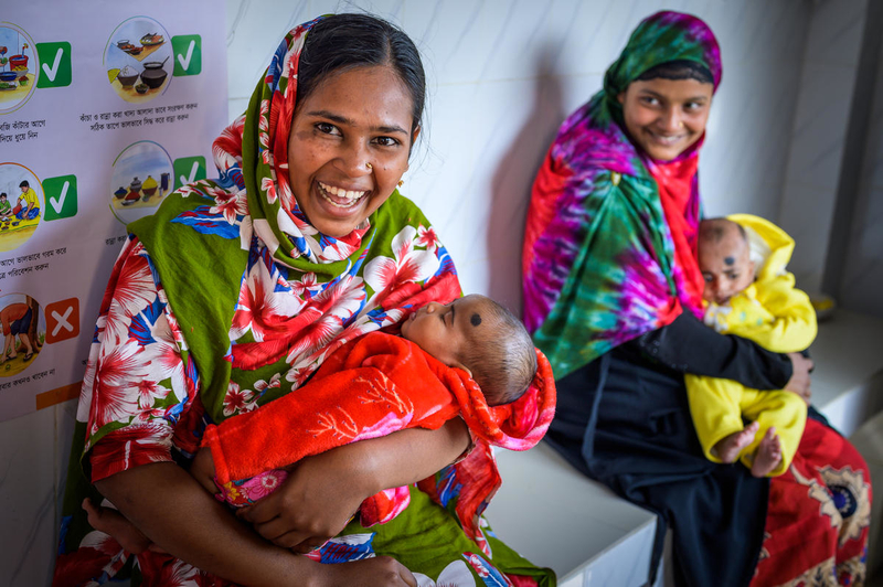 Mothers in Bangladesh hold their new babies