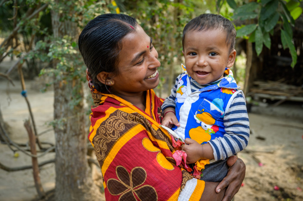 Mother and child who benefited from foreign assistance