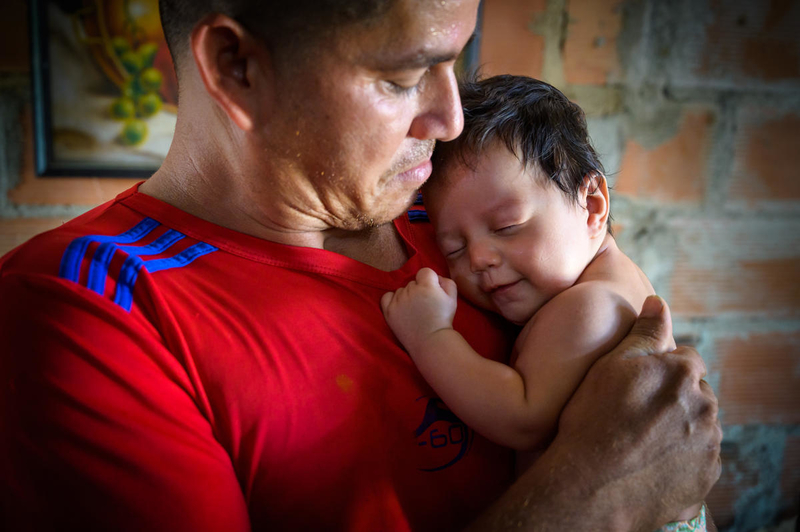 Baby girl with her father in Venezuela.