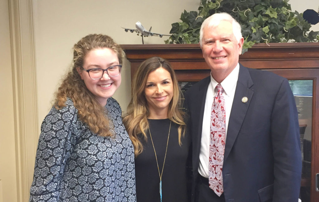 Volunteer combines prayer and action by meeting with representative.