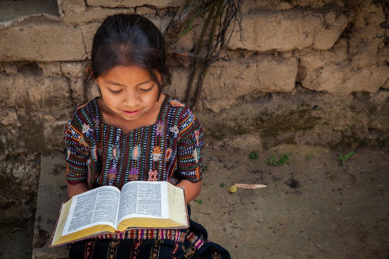 Girl reading Bible in Guatemala