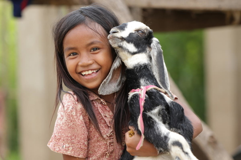 girl thankful for goat