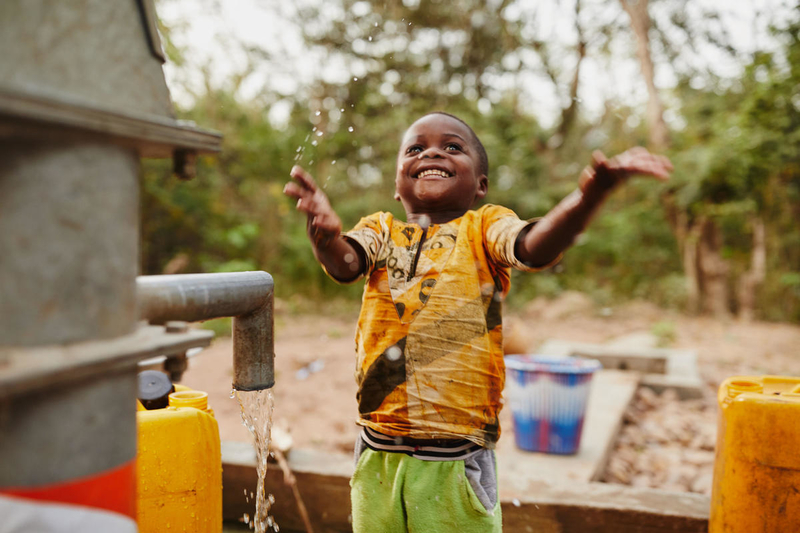 Boy celebrating clean water