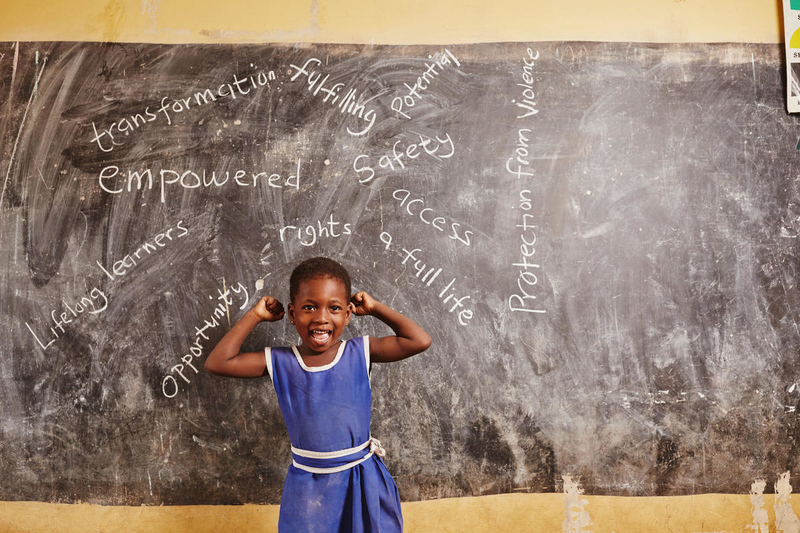 girl in front of chalk board in Ghana