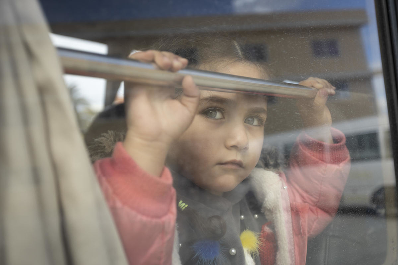 Refugee girl on school bus