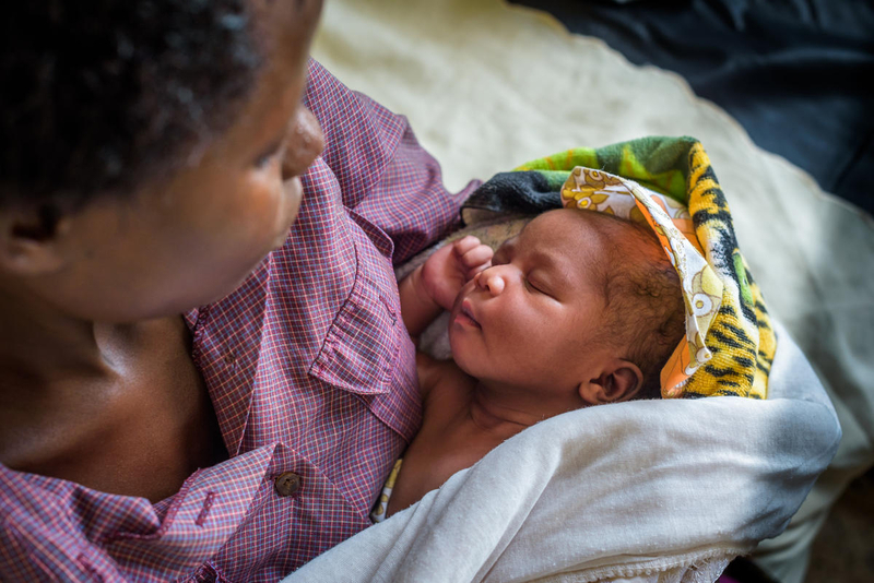 Mom and baby at clinic that helps improve maternal health