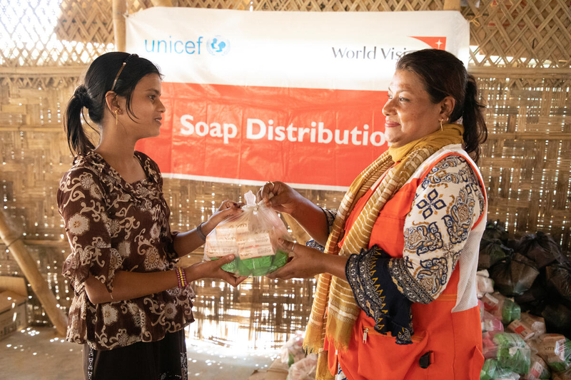 Woman receives hygiene supplies to fight coronavirus