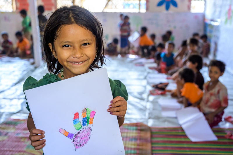 Refugee girl enjoys drawing