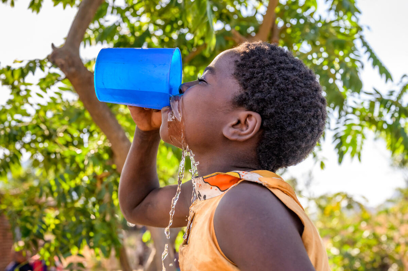 Girl drinks clean water