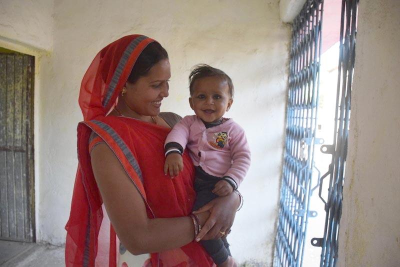volunteer with baby girl