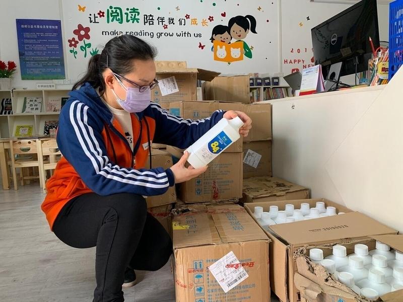 Health worker examines sanitation supplies.