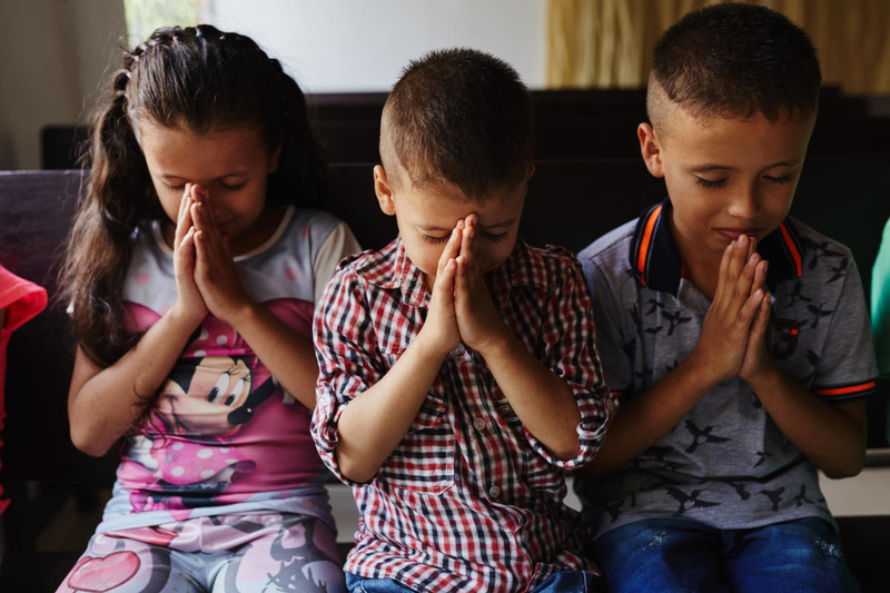 Three children praying
