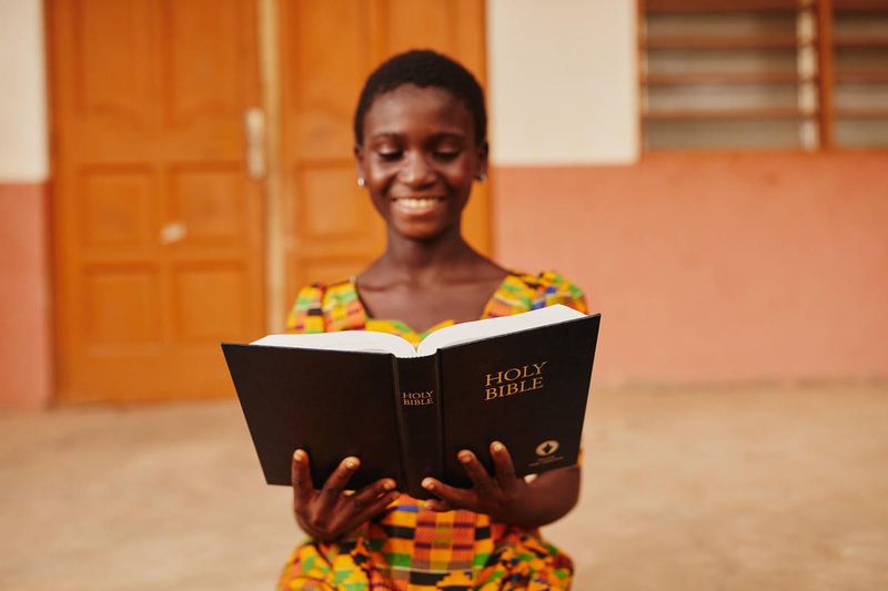 Girl in Ghana reads her Bible