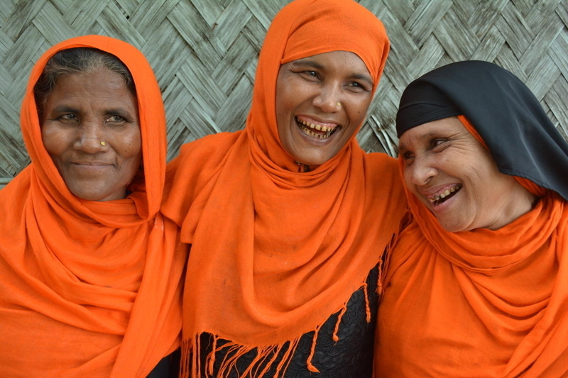 Three refugee women became friends through work in a World Vision Peace Center