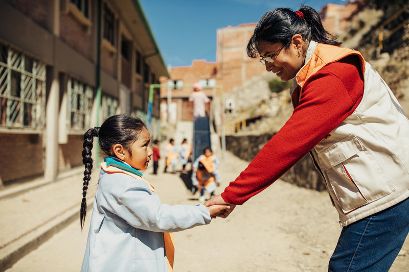World Vision staff member with child in Bolivia