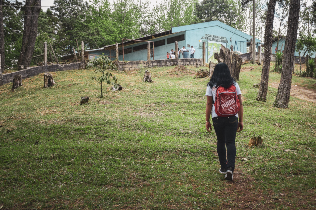 Digna walks to school in Mezcalito, Honduras. Facing the possibility of child labor, Digna was able to pursue education with help from U.S. government aid and World Vision staff in Honduras.